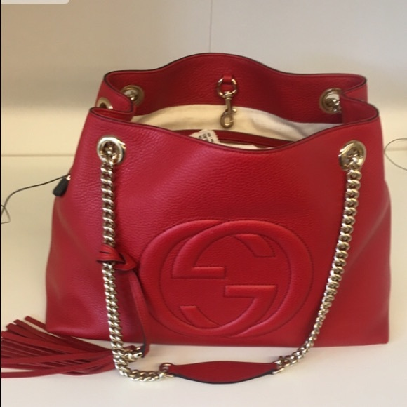 Gucci Handbags - Gucci red new with tags and receipt authentic bag